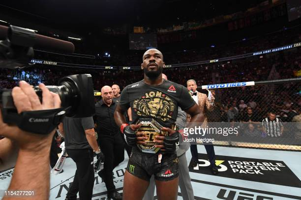 Jon Jones looks on following his win iver Thiago Santos of Brazil in their UFC light heavyweight championship fight during the UFC 239 event at...
