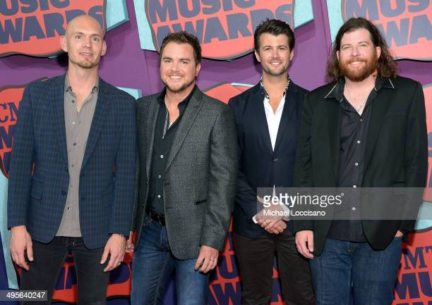 Jon Jones Mike Eli Chris Thompson and James Young of the Eli Young Band attend the 2014 CMT Music awards at the Bridgestone Arena on June 4 2014 in...