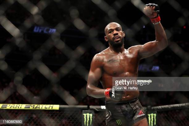 Jon Jones of the United States looks on after his after their UFC Light Heavyweight Title bout with Thiago Santos of Brazil at TMobile Arena on July...