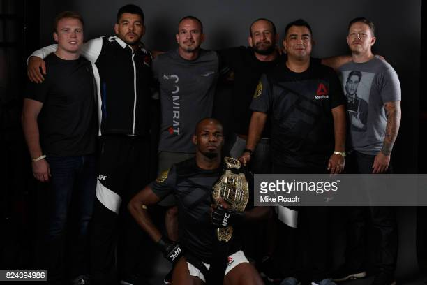 Jon Jones poses for a portrait backstage with his team after his victory over Daniel Cormier during the UFC 214 event at Honda Center on July 29 2017...