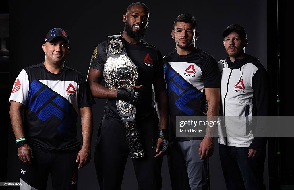 Jon Jones poses for a portrait with his team backstage during the UFC 197 event inside MGM Grand Garden Arena on April 23, 2016 in Las Vegas, Nevada.
