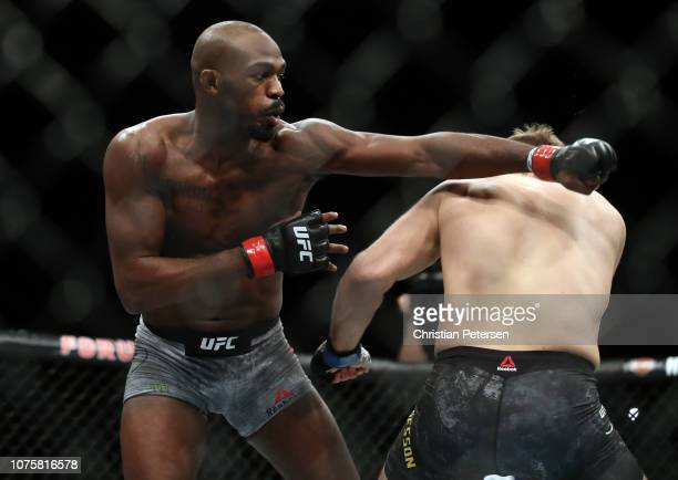 Jon Jones punches Alexander Gustafsson of Sweden in their light heavyweight bout during the UFC 232 event inside The Forum on December 29 2018 in...