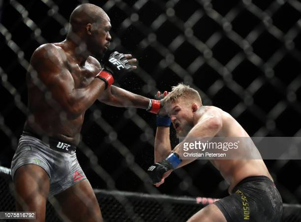 Jon Jones punches Alexander Gustafsson of Sweden in their light heavyweight bout during the UFC 232 event inside The Forum on December 29, 2018 in...