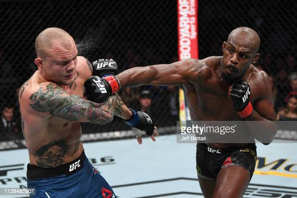 Jon Jones punches Anthony Smith in their UFC light heavyweight championship bout during the UFC 235 event at T-Mobile Arena on March 2, 2019 in Las...