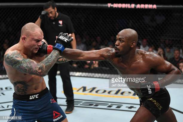 Jon Jones punches Anthony Smith in their UFC light heavyweight championship bout during the UFC 235 event at TMobile Arena on March 2 2019 in Las...