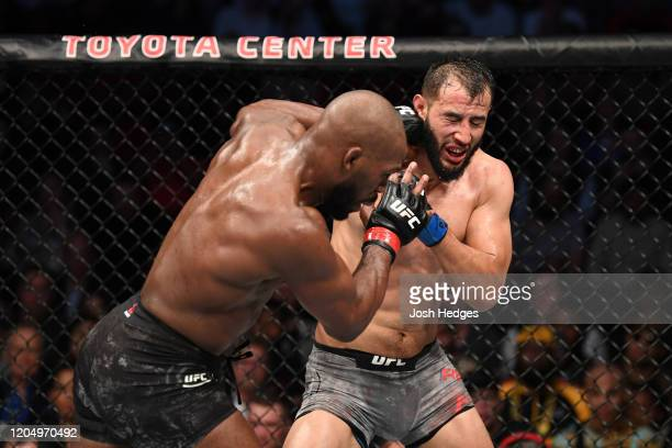 Jon Jones punches Dominick Reyes in their light heavyweight championship bout during the UFC 247 event at Toyota Center on February 08 2020 in...