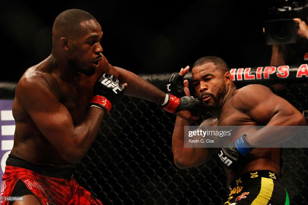 Jon Jones (L) punches Rashad Evans during their light heavyweight title bout for UFC 145 at Philips Arena on April 21, 2012 in Atlanta, Georgia.