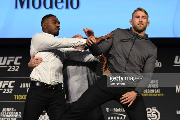Jon Jones pushes Alexander Gustafsson of Sweden during the UFC 232 press conference inside Hulu Theater at Madison Square Garden on November 2 2018...