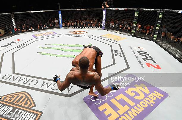 Jon Jones slams Ovince Saint Preux in their interim UFC light heavyweight championship bout during the UFC 197 event inside MGM Grand Garden Arena on...