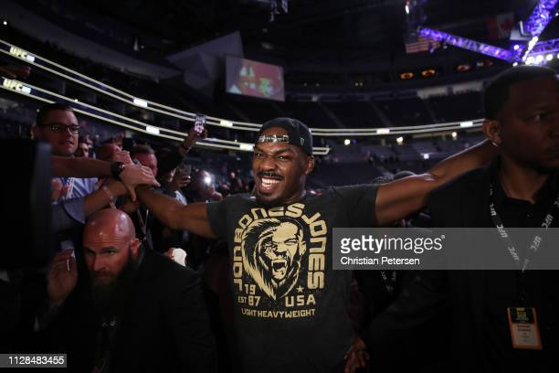 Jon Jones walks out of the arena following his win against Anthony Smith in their UFC light heavyweight championship bout during the UFC 235 event at...