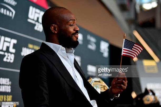 Jon Jones waves a USA flag during the UFC 239 Ultimate Media Day at T-Mobile Arena on July 4, 2019 in Las Vegas, Nevada.