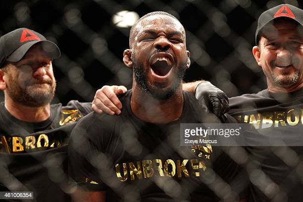 Jon Jones yells out after defeating Daniel Comier in a light heavyweight title fight at the MGM GrandGarden Arena on January 3 2015 in Las Vegas...