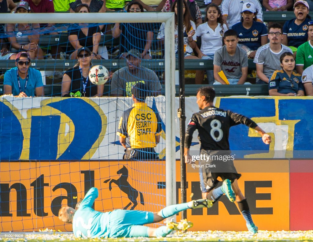 Jon Kempin #22 of Los Angeles Galaxy unsuccessfully tries to save a shot from Chris Wondolowski #8 of San Jose Earthquakes during the Los Angeles Galaxy's MLS match against San Jose Earthquakes at the StubHub Center on August 27, 2017 in Carson, California. San Jose won the match 3-0