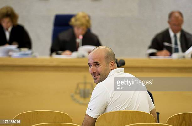 Jon Kepa Preciado aka Oier alleged member of the Basque separatist group ETA smiles during his trial for terrorist destruction at the National Court...
