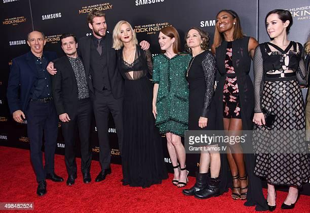 Jon Kilik Josh Hutcherson Liam Hemsworth Jennifer Lawrence Julianne Moore Nina Jacobson Patina Miller and Jena Malone attend The Hunger Games...