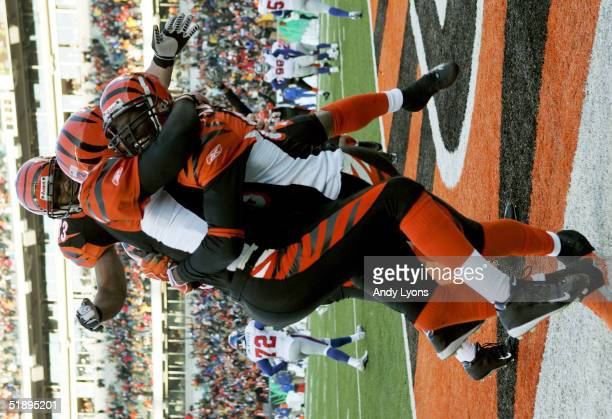 Jon Kitna and Kenny Watson hugs teammate Chad Johnson of the Cincinnati Bengals after catching the winning touchdown pass against the New York Giants...