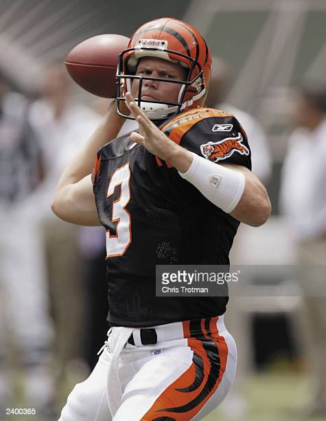 Jon Kitna of the Cinncinnati Bengals passes during warmups before the game against the New York Jets on August 10, 2003 at Giant Stadium in East...