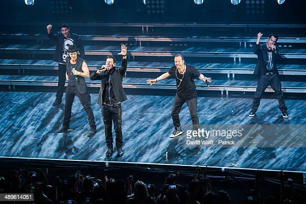 Jon Knight Joey McIntyre Jordan Knight Donnie Wahlberg and Danny Wood from New Kids on the Block perform at L'Olympia on May11 2014 in Paris France