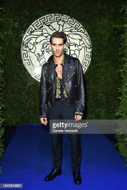 Jon Kortajarena is seen on the front row of the Versace special event during the Milan Fashion Week - Spring / Summer 2022 on September 26, 2021 in...
