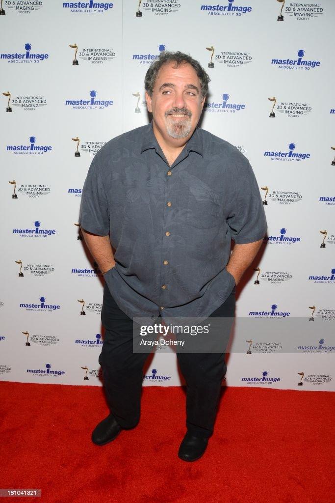 Jon Landau receives an award at the International 3D Society & Advanced Imaging Society 3D Products of the Year Awards at Paramount Studios on September 18, 2013 in Hollywood, California.