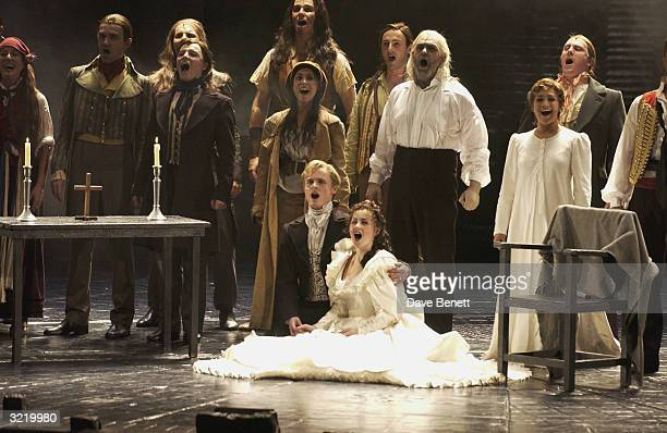 Jon Lee and costars perform on his opening night in Les Miserables on July 29 2003 in London