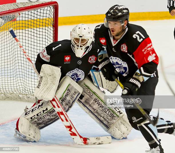 Jon Lee-Olsen of Soenderjyske tends the goal with teammate Anders Overmark during the Champions Hockey League group stage game between Sonderjyske...