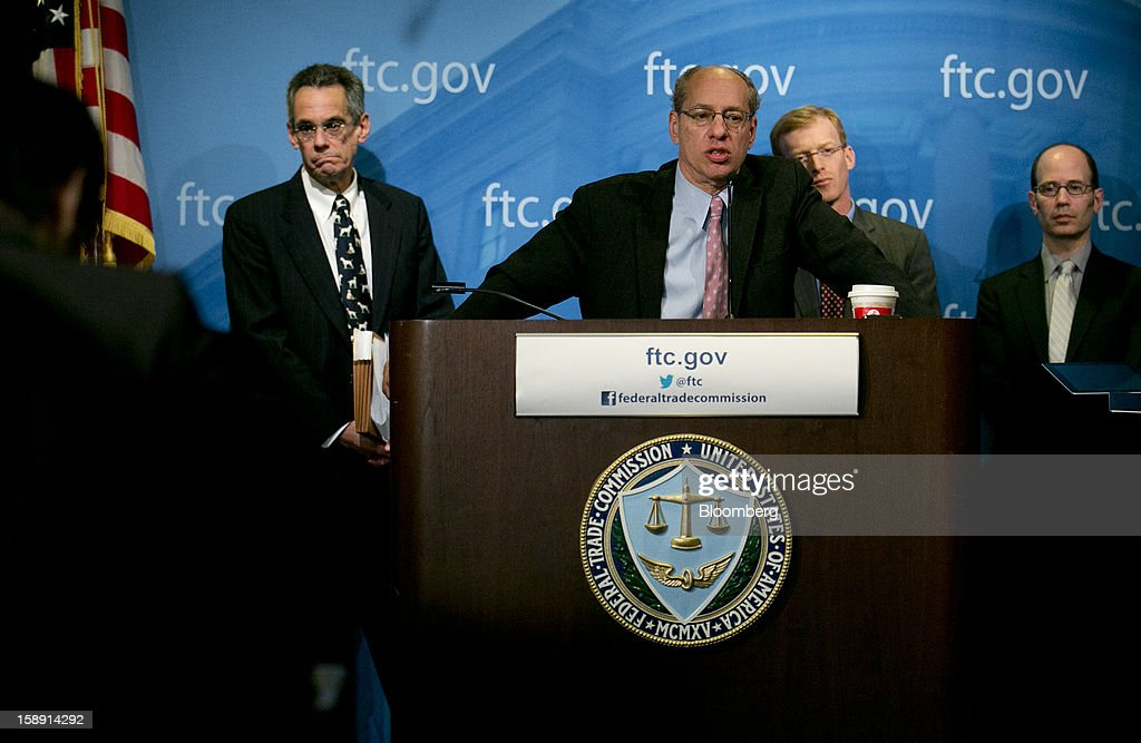 Jon Leibowitz, chairman of the Federal Trade Commission (FTC), center, speaks during a news conference with Richard 'Rich' Feinstein, director of competition with the FTC, left to right, Howard Shelanski, director of the bureau of economics with the FTC, and Peter 'Pete' Levitas deputy director of the FTC, in Washington, D.C., U.S., on Thursday, Jan. 3, 2013. Google Inc. avoiding a potentially costly legal battle with U.S. regulators, ended a 20-month antitrust probe by pledging to change some business practices and settling allegations it misused patents to thwart competitors in smartphone technology. Photographer: Andrew Harrer/Bloomberg via Getty Images