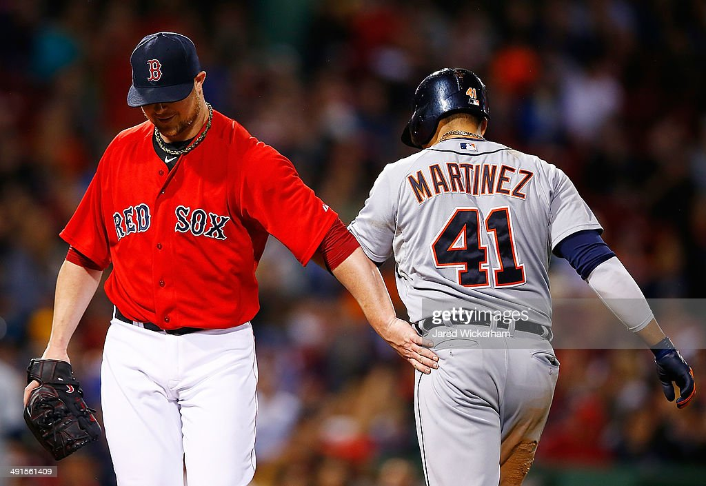 Jon Lester #31 of the Boston Red Sox acknowledges Victor Martinez #41 of the Detroit Tigers in the fifth inning during the game at Fenway Park on May 16, 2014 in Boston, Massachusetts.