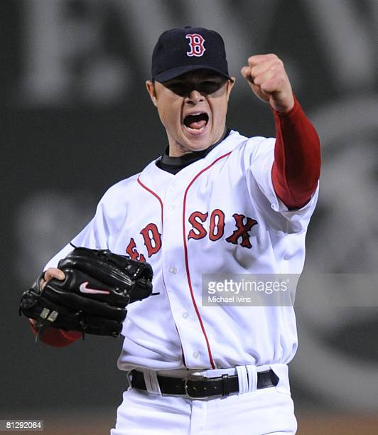 Jon Lester of the Boston Red Sox celebrates after pitching a nohitter against the Kansas City Royals at Fenway Park in Boston Massachusetts on May 19...