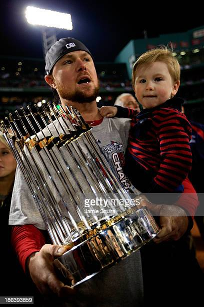 Jon Lester of the Boston Red Sox celebrates with his son Hudson after defeating the St Louis Cardinals 61 in Game Six of the 2013 World Series at...