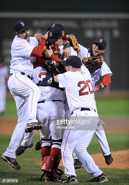 Jon Lester of the Boston Red Sox is greeted by joyful teammates after pitching a nohitter against the Kansas City Royals at Fenway Park in Boston...