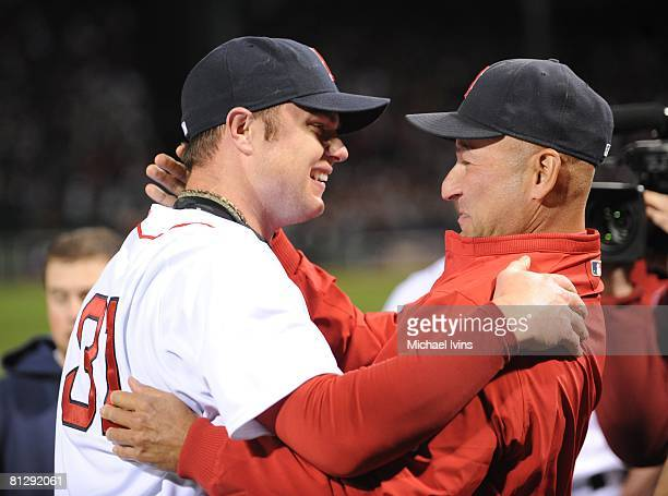 Jon Lester of the Boston Red Sox is greeted by Red Sox Manager Terry Francona after pitching a nohitter against the Kansas City Royals at Fenway Park...