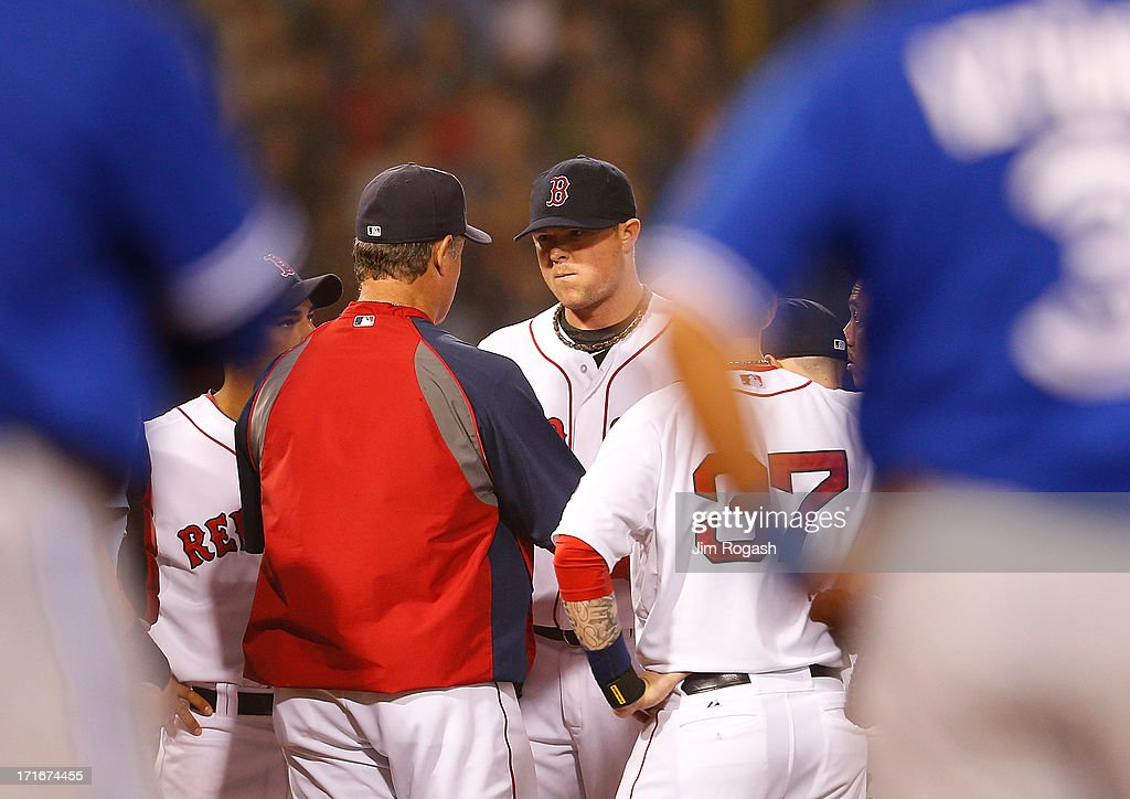 Jon Lester #31 of the Boston Red Sox is taken out of the game in the 8th inning by John Farrell #53 of the Boston Red Sox with men on base against the Toronto Blue Jays at Fenway Park on June 27, 2013 in Boston, Massachusetts.