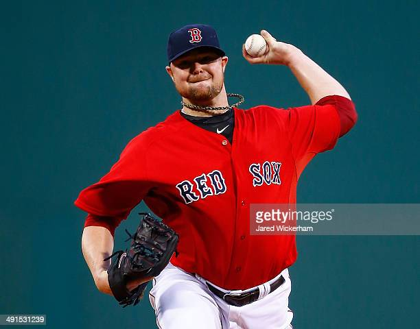 Jon Lester of the Boston Red Sox pitches in the first inning against the Detroit Tigers during the game at Fenway Park on May 16 2014 in Boston...