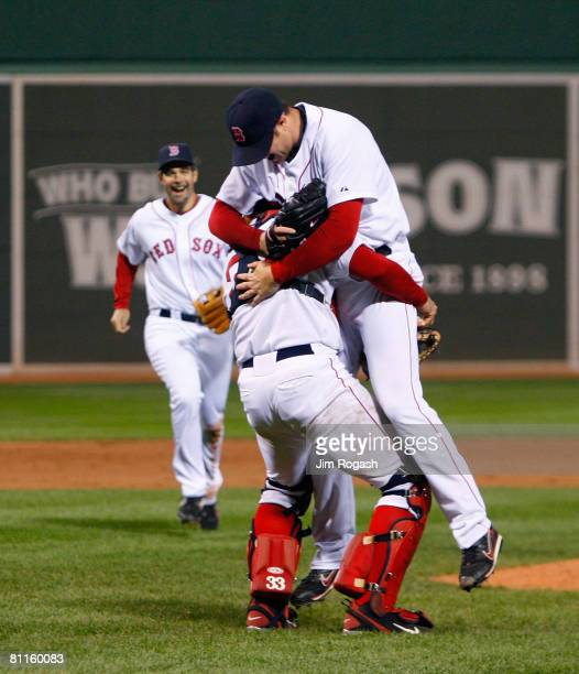 Jon Lester of the Boston Red Sox reacts with teammates Jason Varitek and Mike Lowell after throwing a no hitter against the Kansas City Royals at...