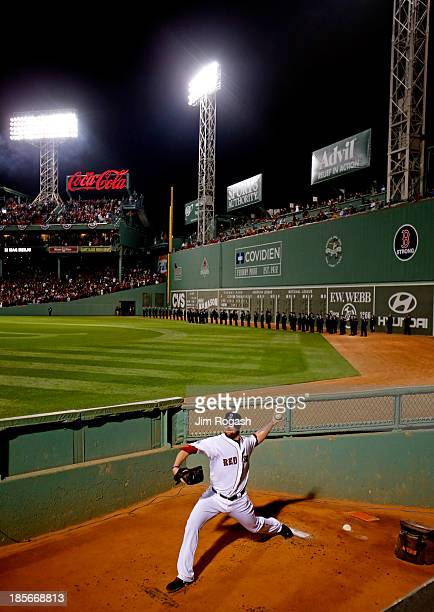Jon Lester of the Boston Red Sox warms up in the bullpen prior to Game One of the 2013 World Series against the St Louis Cardinals at Fenway Park on...
