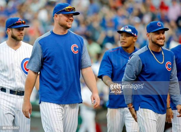 Jon Lester of the Chicago Cubs and Albert Almora Jr #5 smile after their win over the St Louis Cardinals at Wrigley Field on September 17 2017 in...