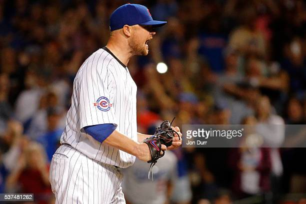 Jon Lester of the Chicago Cubs celebrates after pitching a complete game for the win against the Los Angeles Dodgers at Wrigley Field on June 1 2016...