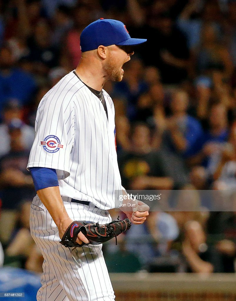 Jon Lester #34 of the Chicago Cubs celebrates after the final out of the eighth inning against the Los Angeles Dodgers at Wrigley Field on June 1, 2016 in Chicago, Illinois.