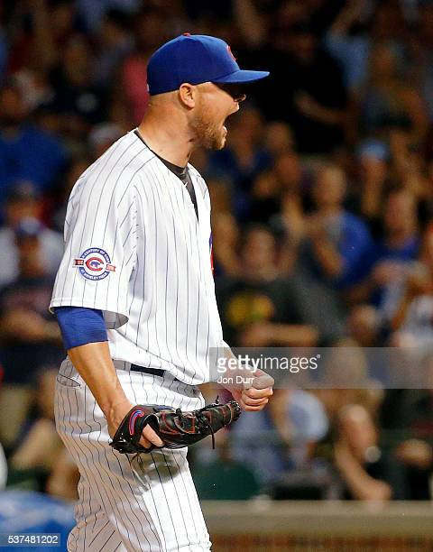 Jon Lester of the Chicago Cubs celebrates after the final out of the eighth inning against the Los Angeles Dodgers at Wrigley Field on June 1 2016 in...