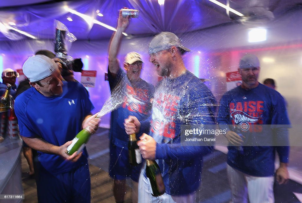 Jon Lester #34 of the Chicago Cubs celebrates in the clubhouse after defeating the Los Angeles Dodgers 5-0 in game six of the National League Championship Series to advance to the World Series against the Cleveland Indians at Wrigley Field on October 22, 2016 in Chicago, Illinois.