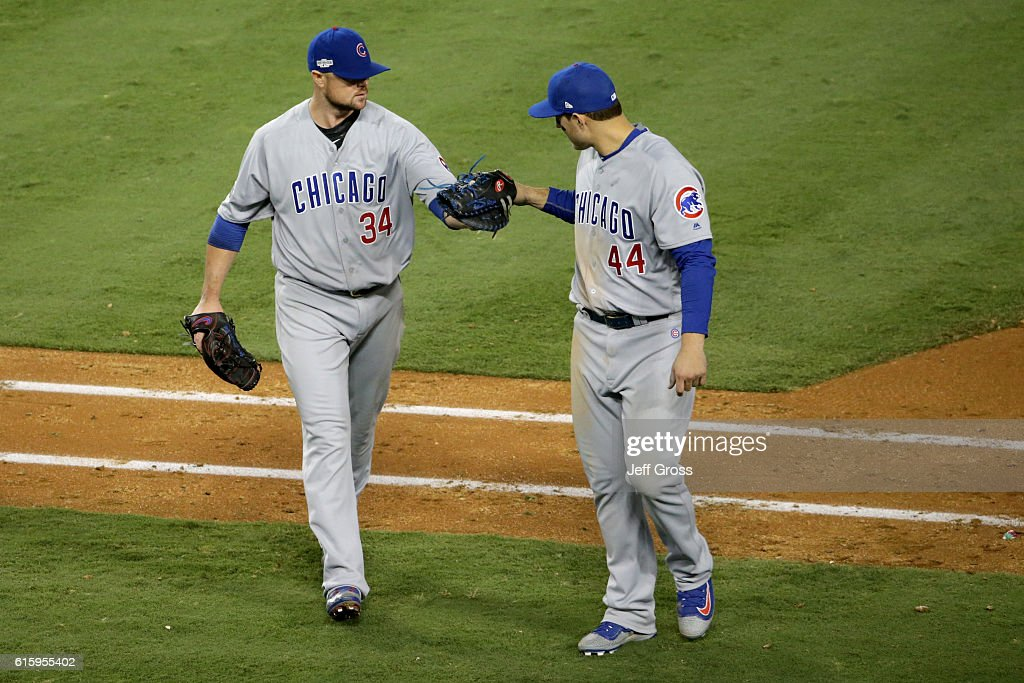 Jon Lester #34 of the Chicago Cubs celebrates with Anthony Rizzo #44 while taking on the Los Angeles Dodgers in game five of the National League Division Series at Dodger Stadium on October 20, 2016 in Los Angeles, California.