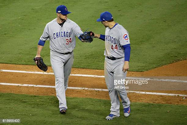 Jon Lester of the Chicago Cubs celebrates with Anthony Rizzo while taking on the Los Angeles Dodgers in game five of the National League Division...