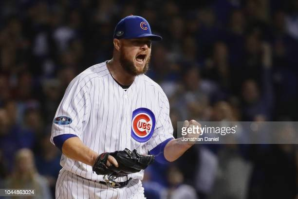 Jon Lester of the Chicago Cubs reacts after striking out Matt Holliday of the Colorado Rockies for the third out in the sixth inning against the...