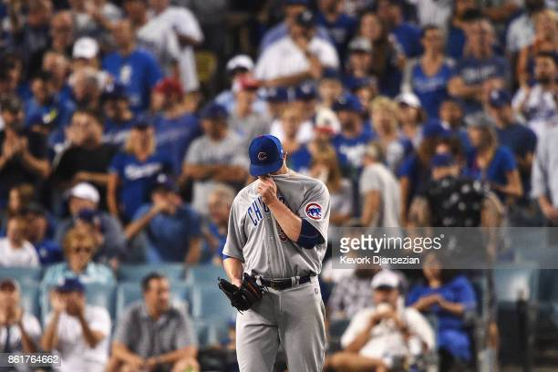 Jon Lester of the Chicago Cubs reacts in the fifth inning against the Los Angeles Dodgers during game two of the National League Championship Series...
