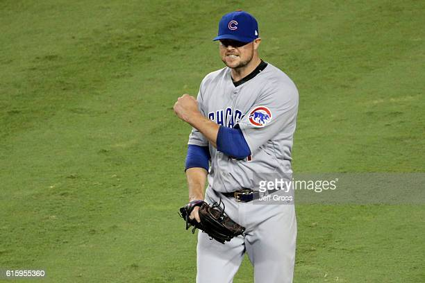 Jon Lester of the Chicago Cubs reacts while taking on the Los Angeles Dodgers in game five of the National League Division Series at Dodger Stadium...