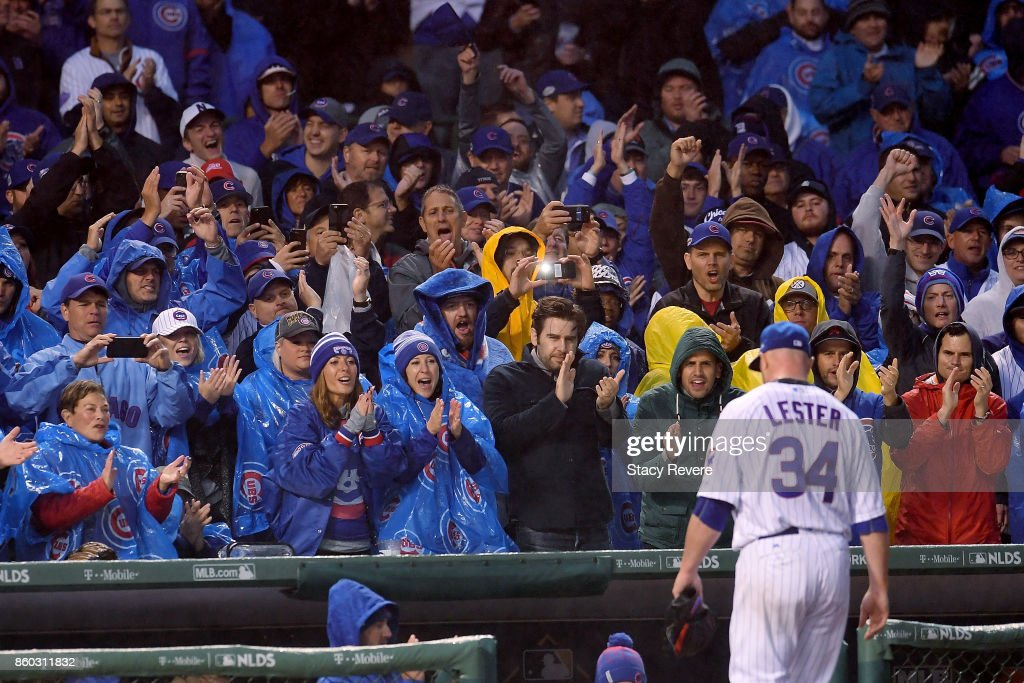 Jon Lester #34 of the Chicago Cubs receives a standing ovation after being relieved in the eighth inning during game four of the National League Division Series against the Washington Nationals at Wrigley Field on October 11, 2017 in Chicago, Illinois.