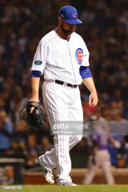 Jon Lester of the Chicago Cubs returns to the dugout during the National League Wild Card game against the Colorado Rockies at Wrigley Field on...