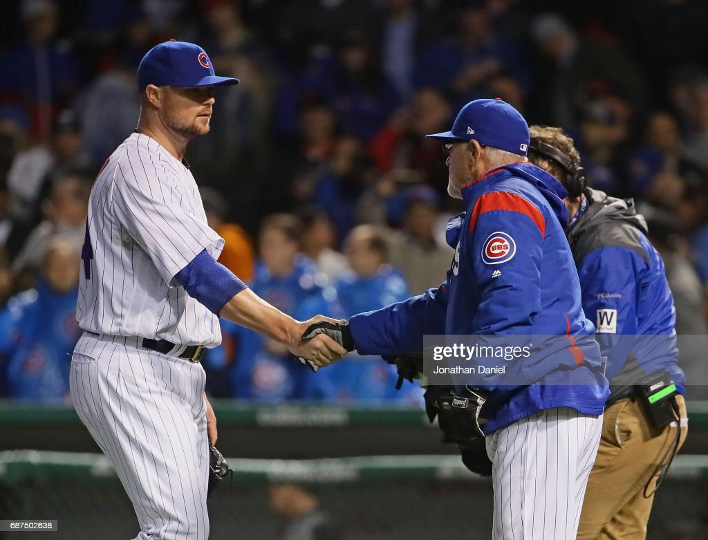 c089507bd4e Jon Lester of the Chicago Cubs shakes hands with manager Joe Maddon ...