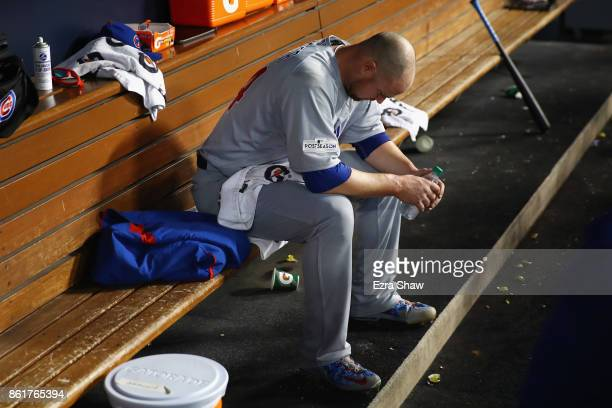 Jon Lester of the Chicago Cubs sits in the dugout after pitching during the fifth inning against the Los Angeles Dodgers in Game Two of the National...